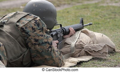 soldier shooting - An Bosnian defense forces soldier dressed..