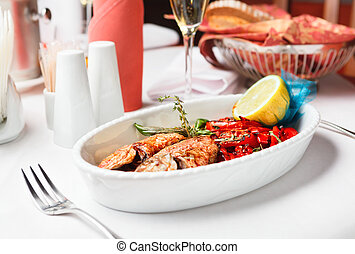 Fried fish with red peppers and lemon