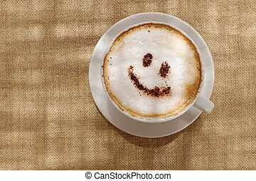 Coffee cappuccino foam or chocolate smiling happy face -...