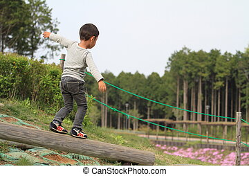 Japanese boy on the balance beam
