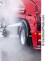 Car Wash - Red truck being washed carefully