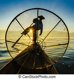 Fishermen in Inle Lake at sunrise, Shan State, Myanmar -...