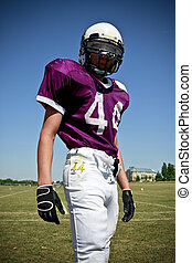 Junior Football Player - Young American Footbalplayer posing