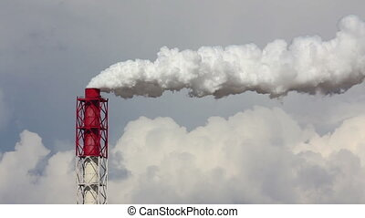 Air pollution by smoke coming out of chimney