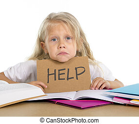 sweet little school girl holding help sign in stress with...