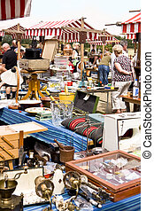 On the flea market - Tables on a flea market full of used...