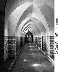 Cloister - Long gothic cloister corridor with corss-shaped...