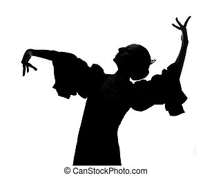 Silhouette of Spanish woman Flamenco dancer dancing...