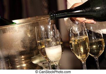 Champagne - A woman is filling a glas with champagne