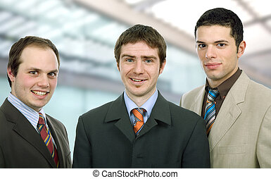 team - three happy business men together as a team