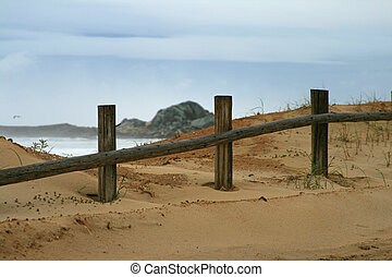 Beyond limits - An old fence by the beach
