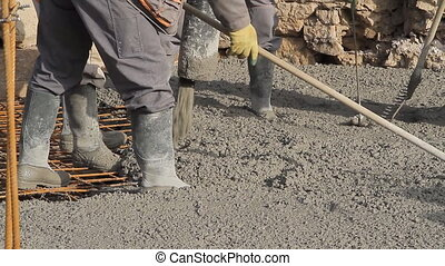 Spreading concrete, compacting liquid cement