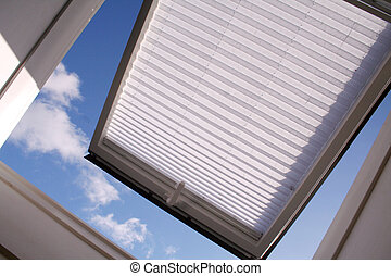 roof window - opened roof window with shutter and clouds