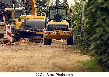 Variety of Construction Heavy Machinery Outdoors on Dirt...