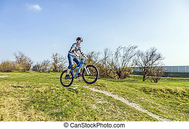 teenage boy racing with his dirt bike - boy racing with his...