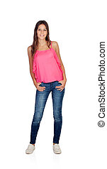 Smiling young girl with jeans standing isolated on a white...