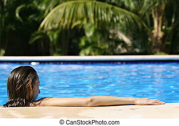 Woman in pool from behind