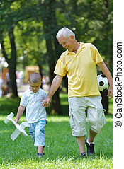 happy grandfather and child in park - happy grandfather and...