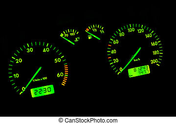 Car dashboard - The green neon car dashboard over a black...