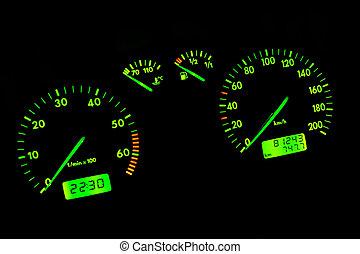 Car dashboard - The green neon car dashboard over a black...