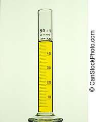 measuring cylinder - glass measuring cylinder with yellow...