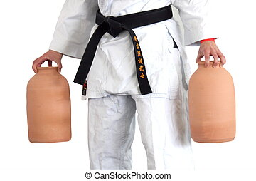 Balancing in karate with vases - People with black belt...