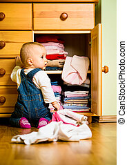 Domestic chores - baby throws out clothes - Baby throws out...