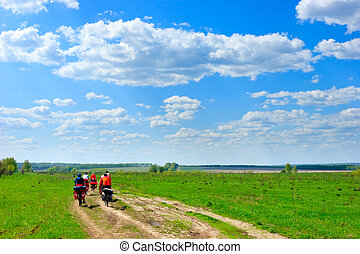 Traveling cyclists - Group of traveling cyclists crossing...