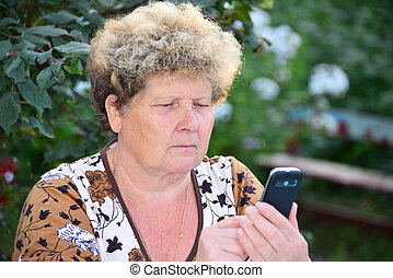 Middleaged woman talks on mobile phone - Middleaged woman...