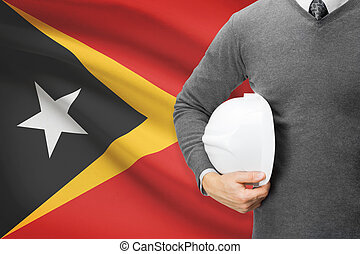 Architect with flag on background - East Timor