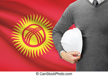 Architect with flag on background  - Kyrgyzstan