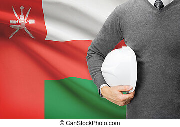 Architect with flag on background  - Oman