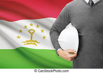 Architect with flag on background - Tajikistan