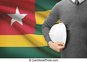 Architect with flag on background - Togo