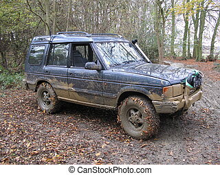 a very dirty muddy offroad car