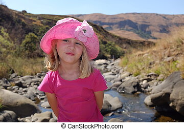 Young vacation girl on relaxing at river