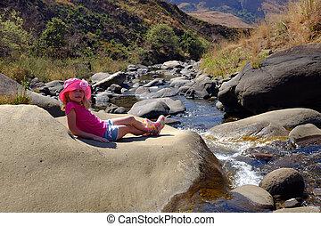 Young vacation girl at river