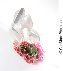 Wedding shoes with flowers on a white background