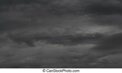 Cloudy stormy black and white dramatic sky, falling dark...
