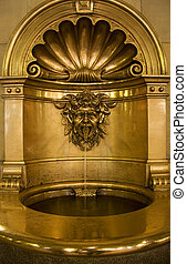 Gold baptismal font that works as a small fountain as well