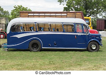 an old fashioned blue luxury coach
