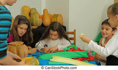Preparatong for Halloween: Children Crafting - Group of...