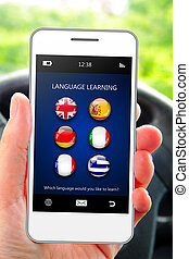 hand holding mobile phone with language learning application...