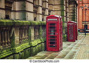 Telephone Booths - Two red british telephone booths in the...