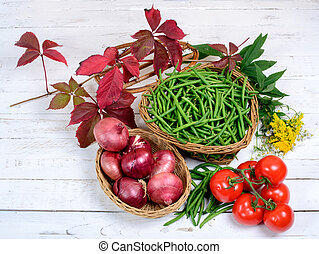 basket of green beans whit tomatoes
