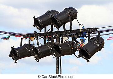Spotlights - six black spotlights at an outdoor concert