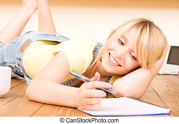 teenage girl with notebook and pen - picture of teenage girl...