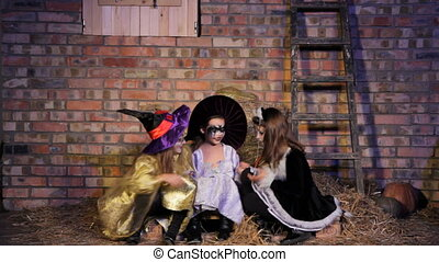Girls In Halloween Costumes Talking - Three girls in...