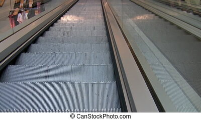Department store escalator - View of moving down empty...