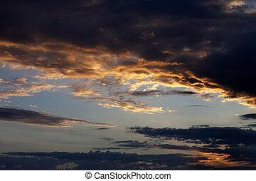 Dark sunset sky on summer sea